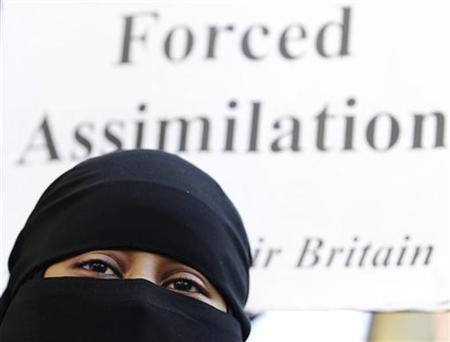 A Muslim woman takes part in a demonstration by the Islamic political party Hizb ut-Tahrir against France's banning of full face veils from public spaces, outside the French Embassy in London September 25, 2010. REUTERS/Luke MacGregor