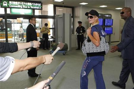 Paris Hilton speaks to the media as she departs Japan from Narita International Airport in Narita, east of Tokyo, September 22, 2010. Celebrity socialite Hilton will likely be denied entry into Japan on Wednesday due to her conviction for possessing cocaine in Las Vegas this week, Kyodo news agency reported. REUTERS/Toru Hanai