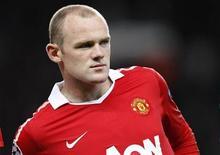 <p>Wayne Rooney do Manchester United durante jogo da Liga dos Campeões em setembro. Rooney deve estar apto a disputar a próxima partida da Inglaterra pelas Eliminatórias da Eurocopa-2012, e só depois disso voltará a atuar pelo Manchester United, disse na sexta-feira o técnico do clube, Alex Ferguson. 14/09/2010 REUTERS/Darren Staples</p>