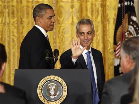 Outgoing White House Chief of Staff Rahm Emanuel waves next to President Barack Obama in the East Room of the White House in Washington October 1, 2010. Emanuel stepped down to run for mayor of Chicago. REUTERS/Larry Downing