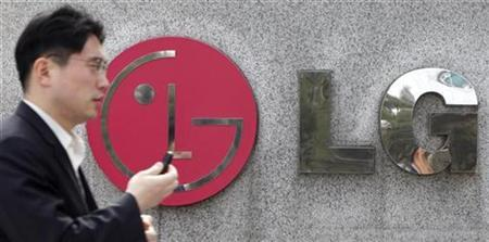 A man walks past the headquarters of LG Electronics in Seoul March 19, 2010. REUTERS/Lee Jae-Won