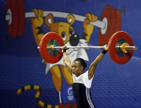 Nigerian weightlifter claims first gold, dashes India ...
