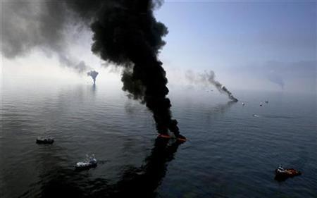 Smoke billows from a controlled burn of spilled oil off the Louisiana coast in the Gulf of Mexico, June 13, 2010. REUTERS/Sean Gardner