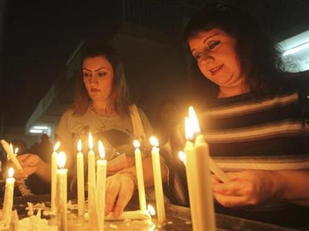 Worshippers light candles after attending a weekly mass at Sacred Heart Catholic Church in Baghdad October 3, 2010. REUTERS/Mohammed Ameen