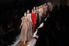 <p>Models present creations by Italian designers Maria Grazia Chiuri and Pier Paolo Piccioli as part of their Spring/Summer 2011 women's ready-to-wear fashion collection for fashion house Valentino during Paris Fashion Week October 5, 2010. REUTERS/Benoit Tessier</p>