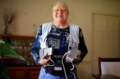 <p>Geri Norris poses for a portrait holding the rechargeable batteries for her Heartmate II Left Ventricular Assist System at her home in Marlborough, Massachusetts September 21, 2010. The device, implanted inside the patient's chest and powered by external, rechargable batteries connected by a cable coming out of the patient's side, pumps blood through the circulatory system on a continuous basis, taking over most of the heart's work. REUTERS/Brian Snyder</p>