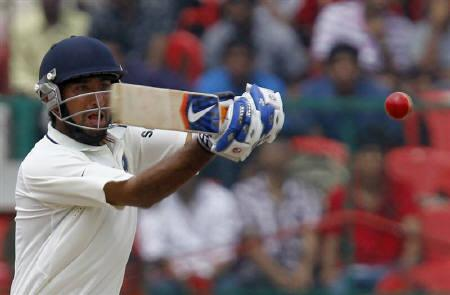 Cheteshwar Pujara plays a shot during the fifth day of their second test cricket match against Australia in Bangalore October 13, 2010. REUTERS/Andrew Caballero-Reynolds