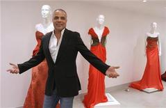 <p>Lebanese designer Abed Mahfouz reacts during an interview with Reuters at his showroom in downtown Beirut, September 15, 2010. REUTERS/Jamal Saidi</p>