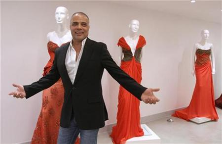Lebanese designer Abed Mahfouz reacts during an interview with Reuters at his showroom in downtown Beirut, September 15, 2010. REUTERS/Jamal Saidi