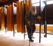 <p>A man leaves the polling booth during the second-round of parliamentary election in Budapest April 25, 2010. REUTERS/Karoly Arvai</p>