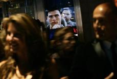 "<p>An image of Tom Cruise from the movie ""Top Gun"" is reflected in a window as people arrive at the Museum of the Moving Image Salute to Tom Cruise in New York November 6, 2007. REUTERS/Shannon Stapleton</p>"