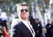 "<p>Judge Simon Cowell arrives for the 9th season finale of ""American Idol"" in Los Angeles May 26, 2010. REUTERS/Mario Anzuoni</p>"