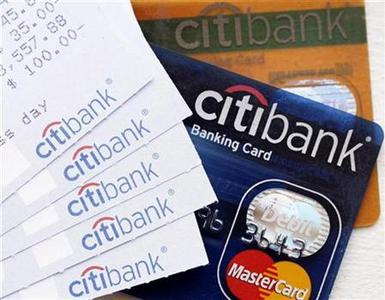 CitiBank regular and gold bank cards, along with several ATM receipts, are seen in this photo illustration taken in New York, April 9, 2008. REUTERS/Chip East