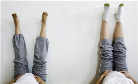 Pregnant women practice yoga in a file photo. REUTERS/Susana Vera