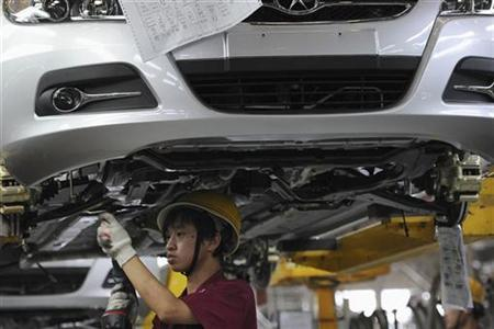 An employee works at the assembly line of Anhui Jianghuai Automobile Co. Ltd in Hefei, Anhui province October 19, 2010. REUTERS/Stringer