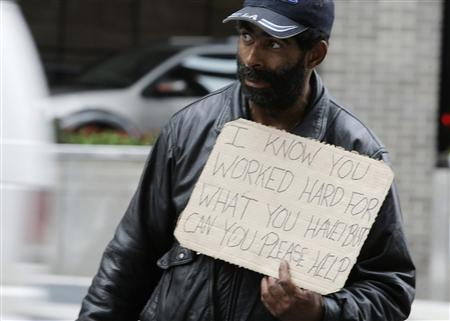 Harvey, a homeless man, begs for money along 14th Street in Washington, October 20, 2010. REUTERS/Stelios Varias