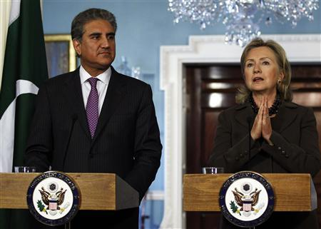U.S. Secretary of State Hillary Clinton (R) and Pakistan's Foreign Minister Shah Mahmood Qureshi hold a news conference after the U.S.-Pakistan Strategic Dialogue Plenary Session at the State Department in Washington October 22, 2010. REUTERS/Jim Young