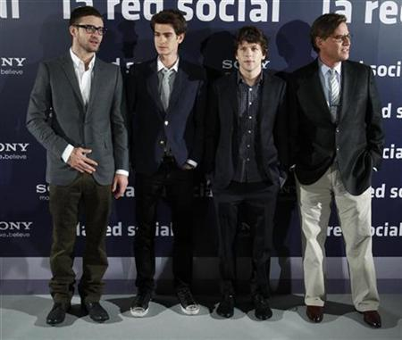 Actors Justin Timberlake (L), Andrew Garfield and Jesse Eisenberg (2nd R) and writer Aaron Sorkin (R) pose during a photocall to promote the movie ''The Social Network'' in Madrid, October 6, 2010. REUTERS/Andrea Comas