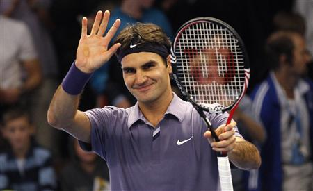 Switzerland's Roger Federer celebrates after defeating Germany's Florian Mayer in the finals of the Stockholm Open tennis tournament in Stockholm October 24, 2010. REUTERS/Bob Strong