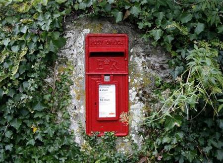 A Royal Mail post box is seen set into a wall in Bohortha, near Portscatho in Cornwall, south western England October 31, 2009. REUTERS/John Voos