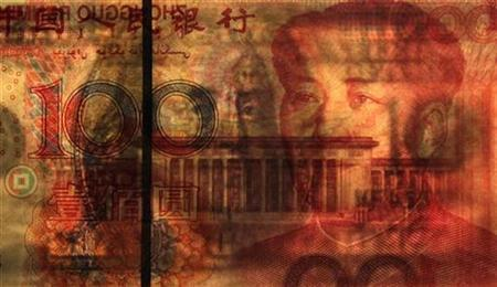 A U.S. $100 banknote is placed on a 100 yuan banknote in this photo illustration taken in Beijing October 17, 2010. REUTERS/Petar Kujundzic