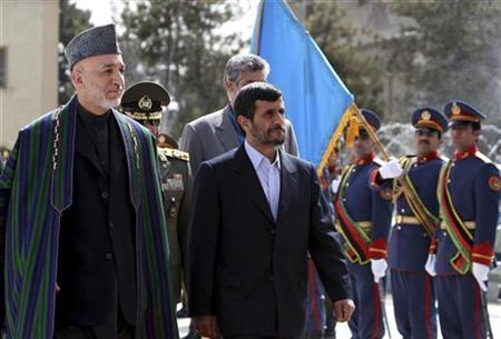 Afghanistan's President Hamid Karzai (L) welcomes his Iranian counterpart Mahmoud Ahmadinejad in Kabul March 10, 2010. REUTERS/Sorkhabi/Pool