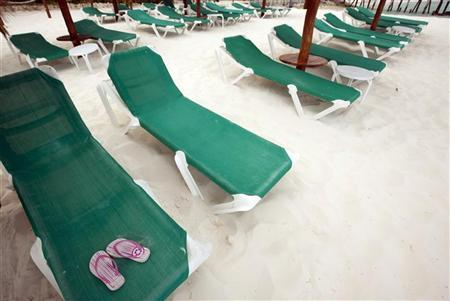 A pair of slippers is seen on a beach chair in Cancun April 13, 2010. REUTERS/Gerardo Garcia
