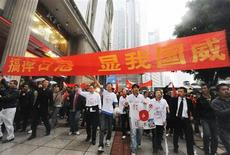 <p>Protesters holding a banner, march toward the Japanese consulate general's office during an anti-Japan demonstration in Chongqing municipality, October 26, 2010. REUTERS/Kyodo</p>