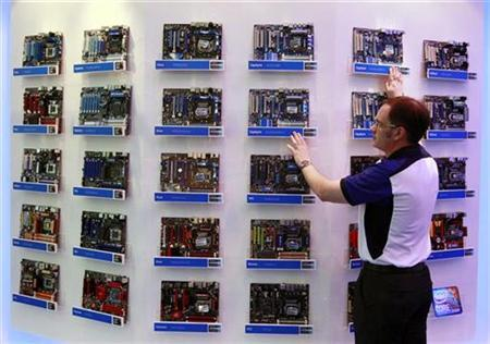 A man looks at Intel motherboards during the Computex 2010 computer fair at the TWTC Nangang exhibition hall in Taipei June 1, 2010. REUTERS/Nicky Loh