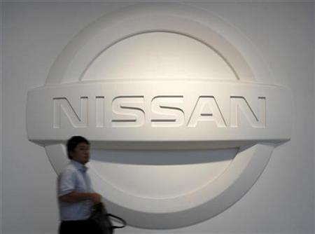 A man walks past a logo of Nissan Motor Co at the company's headquarters in Yokohama, south of Tokyo July 29, 2010. REUTERS/Toru Hanai