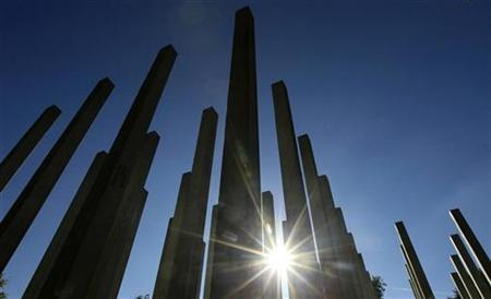 The sun shines through the pillars of a memorial in Hyde Park, in London October 11, 2010. REUTERS/Luke MacGregor