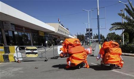 Parcels are seen outside Sanaa International Airport October 30, 2010. REUTERS/Khaled Abdullah