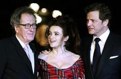 """<p>Actors Geoffrey Rush (L), Helena Bonham Carter (C) and Colin Firth pose on the red carpet before the European Premiere of """"The King's Speech"""" in Leicester Square, in London October 21, 2010. REUTERS/Luke MacGregor</p>"""