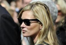 <p>British model Kate Moss leaves the memorial service for Alexander McQueen at St. Paul's Cathedral, London, September 20, 2010. REUTERS/Paul Hackett</p>
