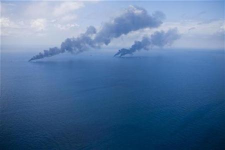 Oil is burned off the surface of the water near the source of Deepwater Horizon oil spill where BP will begin to test a new cap placed over the leak in the Gulf of Mexico off the Louisiana coast July 13, 2010. REUTERS/Lee Celano