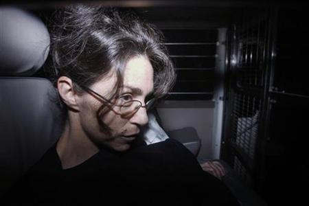 Nancy Kissel, dubbed the ''milkshake'' murderess, sits in a prison van as she arrives at the Court of Final Appeal in Hong Kong, February 11, 2010. REUTERS/Bobby Yip