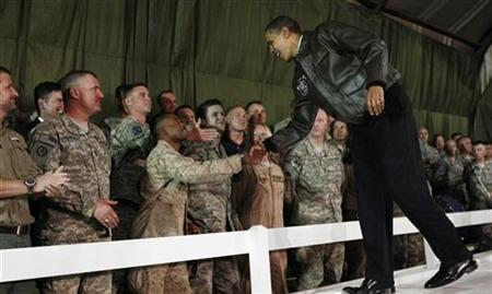 President Barack Obama meets with troops at Bagram Air Base in Kabul, March 28, 2010. REUTERS/Jim Young