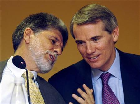 Brazilian Foreign Minister Celso Amorim (L) speaks with U.S. Trade Representative Robert Portman during a news conference that followed a meeting in Rio de Janeiro April 1, 2006. REUTERS/Luciana Whitaker