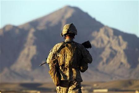 A U.S. Marine from the First Battalion Eighth Marines Alpha Company patrols in the town of Nabuk in southern Afghanistan's Helmand province, October 31, 2010. REUTERS/Finbarr O'Reilly