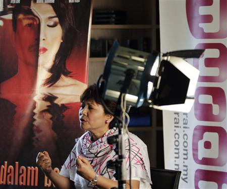 Producer of the Malay language film ''... Dalam Botol'' or ''... In a Bottle'', Raja Azmi Raja Sulaiman, speaks during an interview in Kuala Lumpur November 10, 2010. Malaysia's first gay-themed film, which will open in cinemas in February, is set to raise eyebrows in this conservative, mainly Muslim Southeast Asian country, where homosexuality remains a taboo subject. The original title ''Penis in A Bottle'' which refers to how a transsexual Muslim man keeps her removed male genitalia in a bottle, was rejected by Malaysia's official Islamic authority. Photo taken November 10, 2010. To match Reuters Life! Malaysia-Film/ REUTERS/Bazuki Muhammad