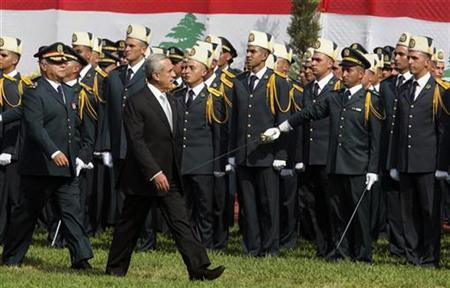 Lebanon's President Michel Suleiman and Lebanon's Army Commander Jean Kahwaji (L) review Lebanese officer cadets during their graduation parade at a military academy in Fayadyeh, near Beirut, on Army Day, August 1, 2010. REUTERS/ Mohamed Azakir