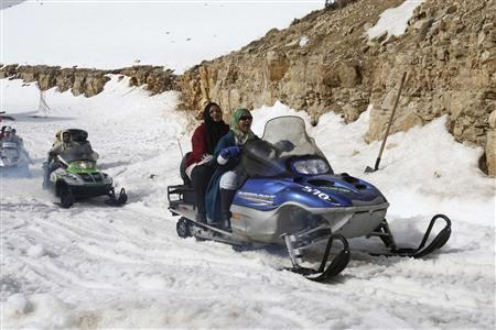 Arab tourists ride skidoos at a ski resort in Faraya, Mount Lebanon, in this February 2, 2010 file photo. REUTERS/Mohamed Azakir/Files