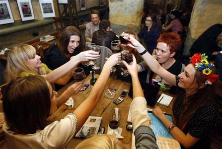 Activists from women's rights organization Femen toast in a downtown Kiev cafe, November 12, 2010. REUTERS/Konstantin Chernichkin