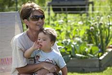 "<p>Former Alaska Governor Sarah Palin and her son Trig are shown in a scene from her new TLC Channel reality series ""Sarah Palin's Alaska"" in this publicity photo released to Reuters November 12, 2010. REUTERS/Gilles Mingasson/TLC/Handout</p>"