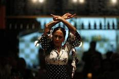 <p>Rosario Fernandez, a 22-year-old flamenco dancer, performs during a show at a restaurant in Malaga, southern Spain November 16, 2010. REUTERS/Jon Nazca</p>