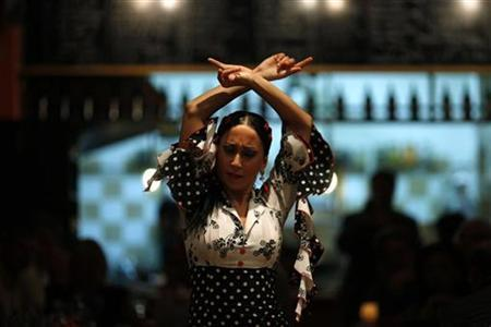 Rosario Fernandez, a 22-year-old flamenco dancer, performs during a show at a restaurant in Malaga, southern Spain November 16, 2010. REUTERS/Jon Nazca