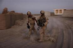 <p>Canadian soldiers head out on a patrol during an operation in the Panjwaii district of Kandahar province, September 20, 2009. Picture taken September 20, 2009. REUTERS/Finbarr O'Reilly</p>