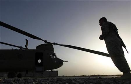 U.S. Army personnel work on a Chinook transport chopper in Kandahar's NATO airfield May 2, 2010. REUTERS/Yannis Behrakis