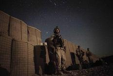 <p>A U.S. Marine waits in the moonlight for a helicopter to transport them home for leave from Musa Qala in southern Afghanistan's Helmand province, November 16, 2010. REUTERS/Finbarr O'Reilly</p>