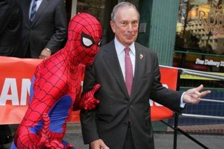 "New York City Mayor Michael Bloomberg and Spider-Man announce the creation of ""Spider-Man, You're Hired,"" an all-new comic book highlighting City resources available to New Yorkers who are navigating the job market, November 17, 2010. REUTERS/Edward Reed/The City of New York"